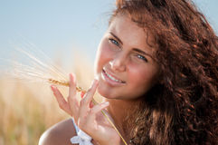 Perfect woman in wheat field Royalty Free Stock Images