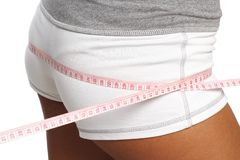 Perfect womans bum  measure  by metre-stick Royalty Free Stock Photography
