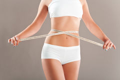 Perfect women body measuring waist Royalty Free Stock Images