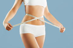 Perfect women body measuring waist Stock Images