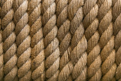 Perfect yellow rough rope texture. Rope background. selective focus.  Stock Photography
