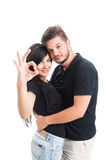 Perfect young couple showing ok gesture Stock Images