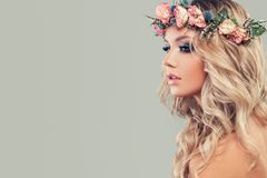 Perfect Young Model with Flowers on Head and Curly Hair royalty free stock photography