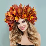 Perfect young woman in autumn leaves crown. Beautiful face with make up, blonde hair and clear skin.  royalty free stock photography