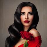 Perfect Young Woman Fashion Model with Long Permed Hairstyle. Red Lips Makeup and Rose Flower Royalty Free Stock Images