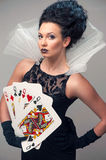 Perfect young woman with playing cards Royalty Free Stock Photo