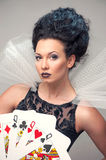 Perfect young woman with playing cards Stock Photography