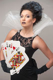Perfect young woman with playing cards Stock Photos