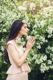 Perfect young woman smelling flower in blossom spring flowers Stock Photos