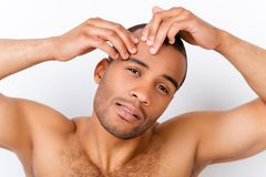 Perfection is a hard work even for men. Pampering, aging, acne,. Pimple, wrinkles, clear and clean, oily, dry skin concept. Cose up cropped photo of worried royalty free stock photography