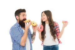 Perfectioneer voor dads met zoete tand Van de meisjeskind en papa verglaasd greep kleurrijk donuts Snoepjes en traktatiesconcept  royalty-vrije stock afbeelding