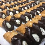 Perfectly baked cannolis on display stock images