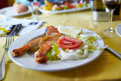 Perfectly cooked red fish salmon with salad Stock Images