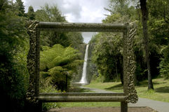 Perfectly framed waterfall. A large pictureframe set in a Regional Park frames the Hunua waterfall in Auckland New Zealand Royalty Free Stock Photos