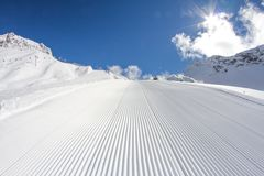 Perfectly groomed empty ski piste Stock Photography