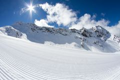 Perfectly groomed empty ski piste Stock Images