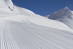 Perfectly groomed empty ski piste Royalty Free Stock Images