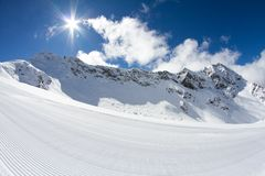 Perfectly groomed empty ski piste Royalty Free Stock Image