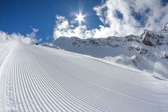 Perfectly groomed empty ski piste Stock Photos