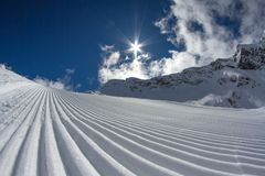 Perfectly groomed empty ski piste Royalty Free Stock Photo