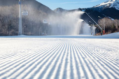 Perfectly groomed empty ski run Royalty Free Stock Photo