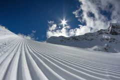 Perfectly groomed ski piste Stock Images