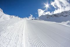 Perfectly groomed ski piste Stock Photos