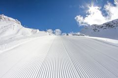 Perfectly groomed ski piste Royalty Free Stock Photo