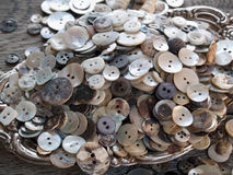 Perfectly imperfect old shell buttons Royalty Free Stock Photography