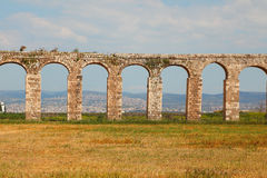Perfectly kept Roman antique aqueduct Stock Photo