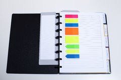 Perfectly organized. Black agenda with organizing coloured elements Royalty Free Stock Image