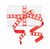 Perfectly packed gift with bow from ribbon hearts Royalty Free Stock Photography