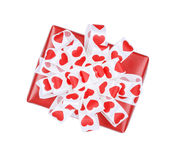 Perfectly packed gift with bow from ribbon hearts Royalty Free Stock Images
