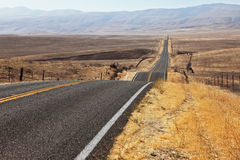 Perfectly smooth highway and desert Royalty Free Stock Image