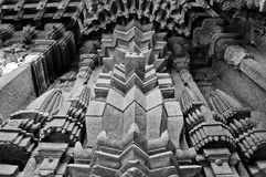 Architectural symmetry. Perfectly symmetric stone carvings seen on the outer walls of the Hoysala-architected temple at Somanathapur, Karnataka. Some portions of Royalty Free Stock Photos
