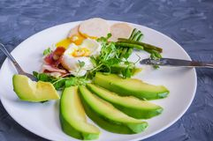 Perfectly toasted avocado toast with a delicious poached egg filling royalty free stock image
