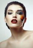 Perfekt makeup med fjärilen Arkivbilder