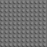 Perfekt vektorlegobakgrund av för glanskonstruktion för closeup det plast- kvarteret för lego grått Royaltyfria Foton