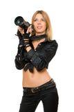 Perfekte junge Frau mit einer Fotokamera Lizenzfreie Stockfotos