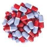 Perfekter Kreis weg von den roten und blauen Tabletten Lizenzfreie Stockfotografie