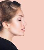 Perfektes weibliches Gesicht gemacht von den verschiedenen Gesichtern Lizenzfreies Stockbild
