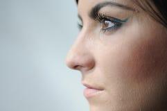 Perfil de la cara izquierda de la mujer joven Imágenes de archivo libres de regalías