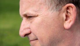 Perfil de la cara masculina humana que sonríe cerca para arriba Imagen de archivo libre de regalías