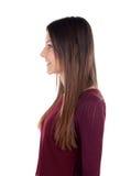 Perfil de la muchacha atractiva que mira el lado Foto de archivo libre de regalías