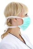 Perfil de la mujer del cirujano en máscara Fotos de archivo