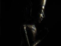 Perfil de oro oscuro de Buda Imagen de archivo libre de regalías