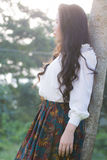 Perfil de um olhar asiático novo da mulher Foto de Stock