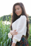Perfil de uma mulher asiática nova Fotografia de Stock
