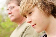 Perfil de un padre y de un hijo Fotografía de archivo libre de regalías