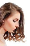 Perfil de una mujer joven hermosa con la mirada del maquillaje de la tarde Fotografía de archivo libre de regalías